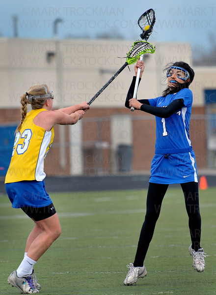 Skippers Abbey Brodeur, right, moves the ball past Wayzata's Amber Schwab in the first half of Minnetonka's 13-6 defeat of the Trojans at Wayzata Thursday, April 21, in Plymouth.