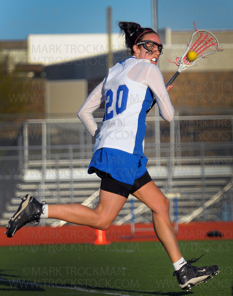 Royals senior Mackenzie Miller sprints toward Minnetonka's goal in the first half of Hopkins 14-7 conference win against the Skippers Thursday, April 15, at Hopkins High School.