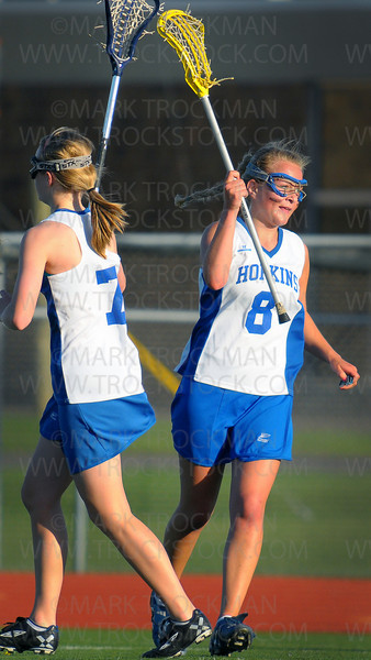 Hopkins senior Leah Agneberg, right, celebrates an early goal against Minnetonka Thursday, April 15, at Hopkins HIgh School.  The Royals defeated their conference rivals 14-7.