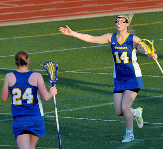 Trojans senior attacker Taylor Kramer exults after scoring against Hopkins Thursday, April 26, in Minnetonka.  Wayzata beat the Royals 9-6 in Lake Conference action.