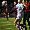 Blake junior midfielder Lydia Sutton (22) controls the ball while double-teamed by Alexandria players as the Bears shutout the Cardinals 2-0 in their class 1-A matchup Thursday, Oct. 25, in Roseville.