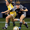 Wayzata senior forward Summer Johnson, left, collides with White Bear Lake junior defender Jordyn Foley in the first half of the Trojans 2-0 class 4A state championship win Thursday, Nov. 1, at the Metrodome in Minneapolis.