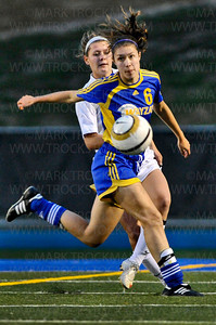 Wayzata's lone goal scorer, senior forward Summer Johnson (6) gets between the ball and Minnetonka senior defender Maggie Bazany in first-half action Thursday, Sept. 20, at Minnetonka.  The Trojans and Skippers tied 1-1 in overtime.