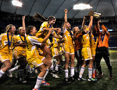 The Wayzata girls soccer squad ecstatically shows off their hard won, class 4A, state championship trophy after beating White Bear Lake 2-0 to clinch the title Thursday, Nov. 1, at the Metrodome in Minneapolis.