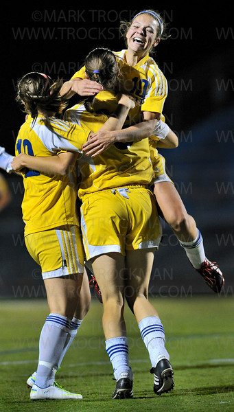 Trojans, left to right, Kylie Schwarz, Summer Johnson and Maddie Eklin, celebrate Johnson's first half goal against Hopkins Tuesday, Oct. 16, at Wayzata High School.  Wayzata trounced the Royals 7-1 to clinch the section final and move on to the state tournament.