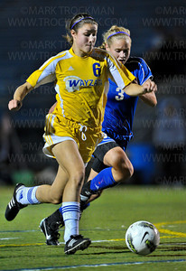 Wayzata senior forward Summer Johnson (6) moves the ball past Royals sophomore defender Rachel Lee in first-half action Tuesday, Oct. 16, at Wayzata High School.  Wayzata trounced the Royals 7-1 to clinch the section final and move on to the state tournament.