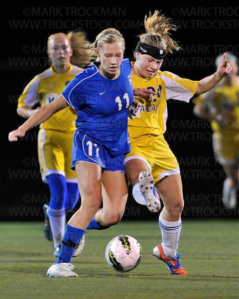 Hopkins junior forward Jillaine DeYoung (11) tangles with Trojans junior defender Katie Yeager Tuesday, Oct. 16, at Wayzata High School.  Wayzata crushed the Royals 7-1 to clinch the section final and move on to the state tournament.
