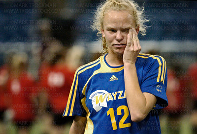 Wayzata senior midfielder Sarah Rounds walks off the field after the Trojans lost their 2008 Minnesota state soccer tournament finale bid to Woodbury Tuesday, Oct. 28 at the H.H.H. Metrodome in Minneapolis.