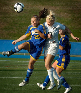 Minnetonka forward Leah Kramer, center, battles for the ball with an unidentified Wayzata player Thursday, Sept 18 at Minnetonka High School.  The Trojans beat the Skippers 3-2.