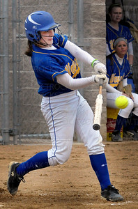 Wayzata's Jessica Williams hits a home run against Hopkins Thursday, April 28.  Wayzata lost to their Lake Conference rivals 5-4.
