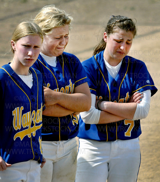 iiiEmotions ran high for Wayzata players, left to right, Rosalie Wilson, Kelsey Kleist, and pitcher Jessica Williams immediately following the Trojans 9-2 Section 6-3A Fastpitch Tournament loss to Hopkins Thursday, June 2, at Richfield Middle School.