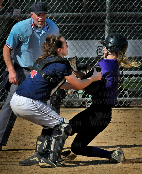 Spartan catcher Shelby Early stops a Chaska baserunner before she can reach home plate during Orono's 4-3 defeat of the Hawks Wednesday, May 11, at Orono High School.