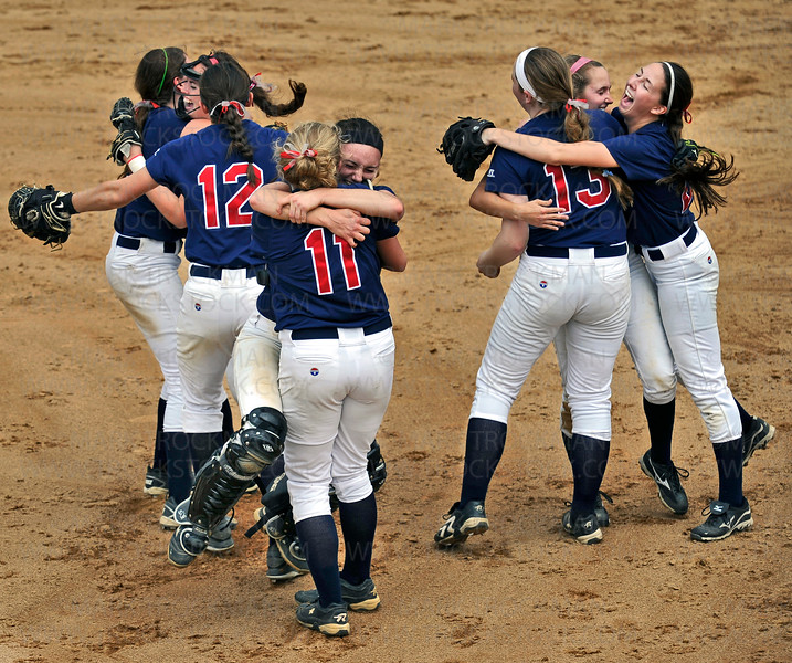 The Orono Spartans celebrate their 7-2 defeat of Edina in the Sec. 6-3A softball championship game Thursday, June 30, at Richfield Middle School.