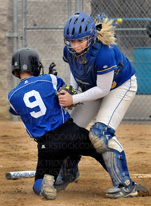 Royals infielder Heidi Fieldseth (9), is tagged at home plate by Wayzata catcher Kelsey Kleist to end the third inning Thursday in Minnetonka.  Hopkins beat the Trojans 5-4.