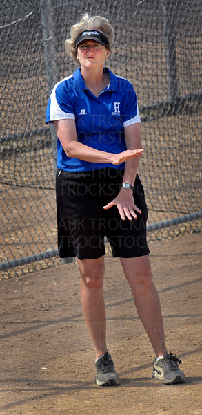 Hopkins head coach Anne Campbell signals to a batter from the third base coaching position in the final inning of the Royals 9-2 Section 6-3A Fastpitch Tournament win against Wayzata Thursday, June 2, in Richfield.