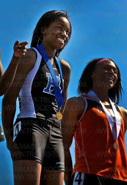 Hopkins junior Taylor Anderson won gold after setting the Minnesota state meet record in the Girls 100 meter dash Saturday, June 9, at Hamline University.  Anderson's winning time was 11.71.
