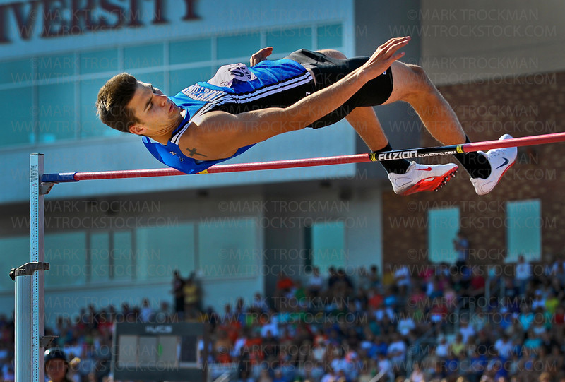 Minnetonka senior Jaime Crum clears the bar at 6-7, tying him for second place in the high jump at the Class 2A state track and field meet Saturday, June 9, at Hamline University in St Paul.