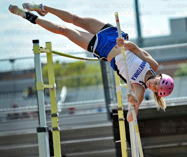 Minnetonka pole vaulter Anna Benke muscles over the bar, clearing  11-feet at the True Team Track and Field meet Wednesday, May 9, at Eden Prairie High School.