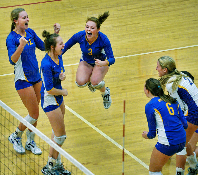 The Wayzata squad puts another point on the board against the formidable Eden Prairie defense Thursday, Oct. 13, at Eden Prairie High School.  Wayzata ultimately lost the match 3-2 with game scores, 25-17, 17-25, 25-20, 17-25, 15-10.