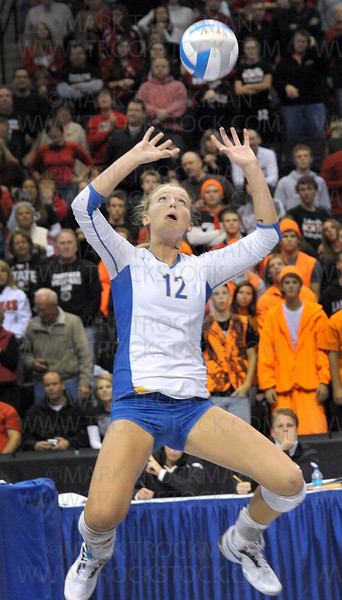 Junior setter Julia Doyle plies her craft against class 3A rival Lakeville North in the state championship match Saturday, Nov. 13, in St. Paul at the Xcel Energy Center.