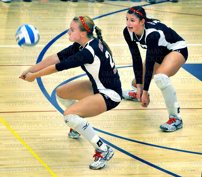 Orono team captain Lexi Rinde, left, digs the ball with support from freshman Paige Broghammer in Orono's 25-13, 21-25, 25-14, 25-19, loss to Hopkins Tuesday, Sept. 7, 2010, at Orono.