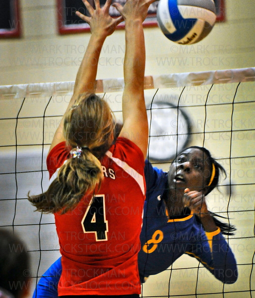 Wayzata junior middle hitter Toni Okuyemi (8) slams the ball past Shakopee outside hitter Carlee Hoppe in varsity action Tuesday, Sept. 14, 2010 at Shakopee.  Wayzata won the match the in straight games 25-23, 25-20, 25-18.