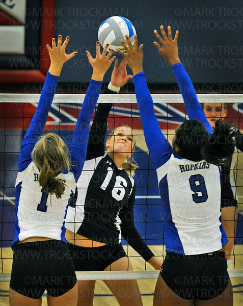 Spartans senior middle blocker Kaily Morgan (16) tries to get one past Hopkins defenders Becca Woodstra (1) and Taylor Lockett (9) in match play Tuesday, Sept. 7, 2010, at Orono High School.  The Royals beat Orono, 25-13, 21-25, 25-14, 25-19.