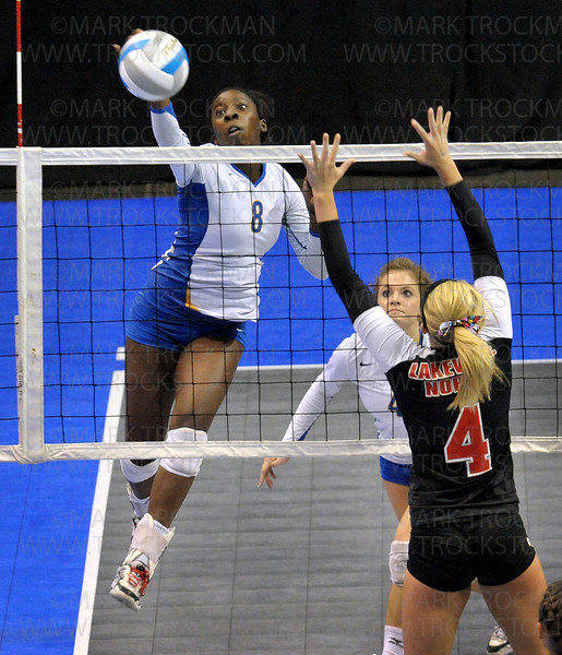 Wayzata middle hitter Toni Okuyemi, left, slams the ball past Lakeville North outside hitter Alyssa Goehner in class 3A state volleyball championship play At Xcel Energy Center in St. Paul Saturday, Nov. 13.