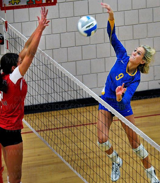 Trojans senior Callie McKown's smacks a  kill shot against Eden Prairie Thursday, Oct. 13, at Eden Prairie High School.  Wayzata ultimately lost the match 3-2 with game scores, 25-17, 17-25, 25-20, 17-25, 15-10.