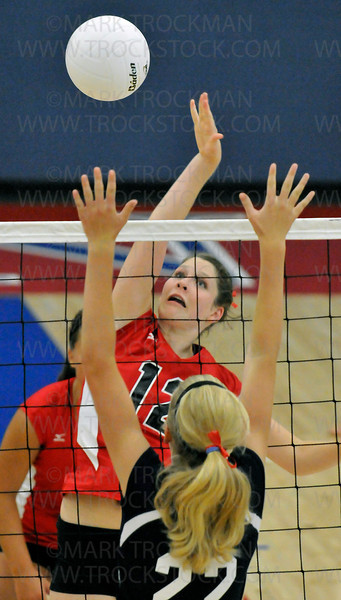 Mound-Westonka senior hitter Emily Wise, top, goes above the net against Orono's Emily Meyer in the first game Sept. 15 in Orono.