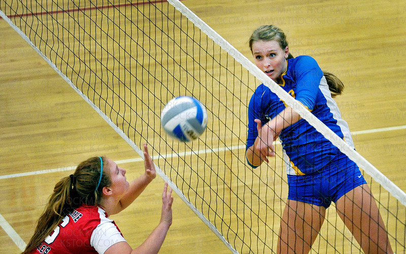 Trojans senior setter Julia Doyle, right, puts one past the formidable Eden Prairie defense Thursday, Oct. 13, at Eden Prairie High School.  Wayzata ultimately lost the match 3-2 with game scores, 25-17, 17-25, 25-20, 17-25, 15-10.