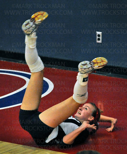 Spartans senior team captain Lexi Rinde goes head over heels against Hopkins Tuesday, Sept. 7, 2010, at Orono High School.  Hopkins beat the Spartans, 25-13, 21-25, 25-14, 25-19.