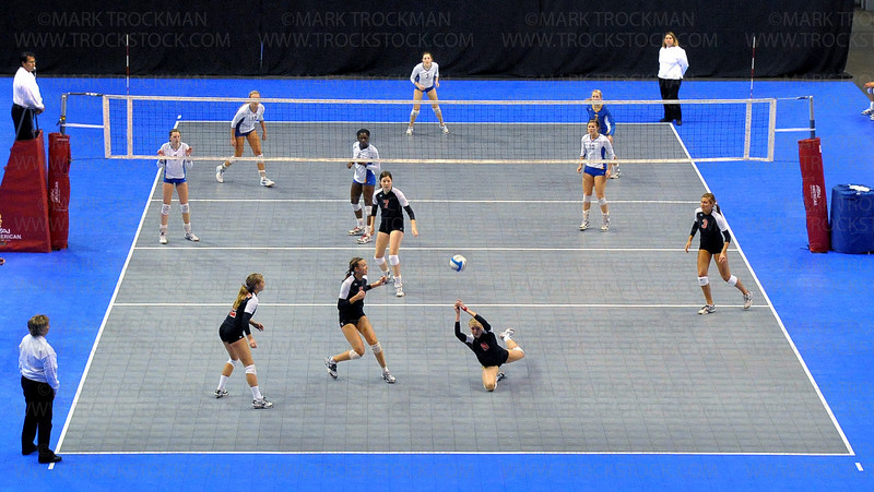 The Wayzata volleyball squad, top, plays a point against Lakeville North Saturday, Nov. 13, at Xcel Energy Center in St. Paul.  The Trojans lost the class 3A state championship match to the Panthers 25-13, 25-18, 25-13.