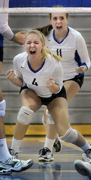 Minnetonka junior Emily Siefering (4) shows the intensity of the Skippers Lake Conference match against Wayzata Tuesday, Sept. 27, at Minnetonka High School.  The Trojans beat the Skippers, 28-26, 25-21, 24-26, 19-25, 15-11.