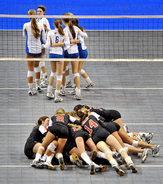 The Lakeville North volleyball team, bottom, celebrates their class 3A state championship against Wayzata immediately after the last point was played Saturday, Nov. 13, at Xcel Energy Center in St. Paul.  The Panthers won in straight sets 25-13, 25-18, 25-13.