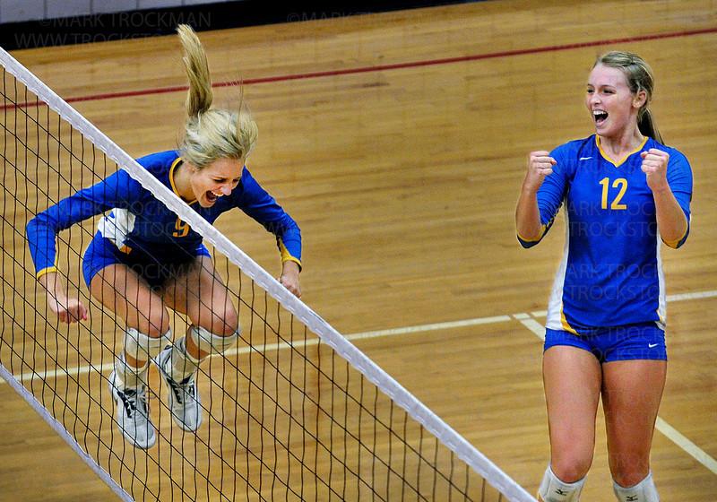 Trojans senior Callie McKown, left, celebrates her point against Eden Prairie with Julia Doyle Thursday, Oct. 13, at Eden Prairie High School.  Wayzata ultimately lost the match 3-2 with game scores, 25-17, 17-25, 25-20, 17-25, 15-10.