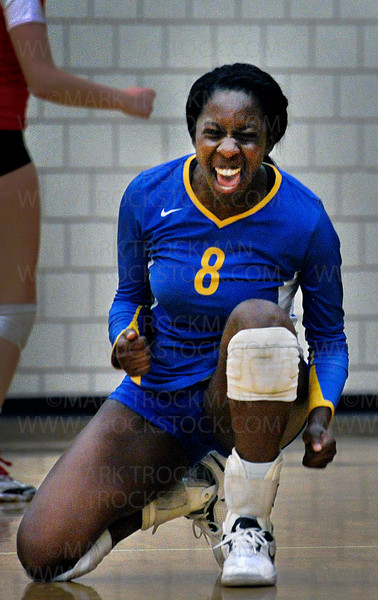A sweet game victory shows on senior Toni Okuyemi's face during the Trojans 3-2 loss to Eden Prairie Thursday, Oct. 13, at Eden Prairie High School.  Wayzata ultimately lost with game scores, 25-17, 17-25, 25-20, 17-25, 15-10.