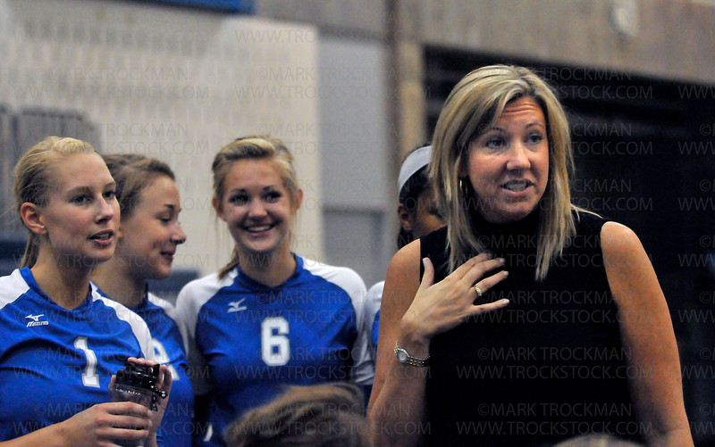 Hopkins head volleyball coach Vicki Seliger Swenson, right, strategizes with her players during a timeout against Centennial Sept. 2, at Hopkins High School in Minnetonka.