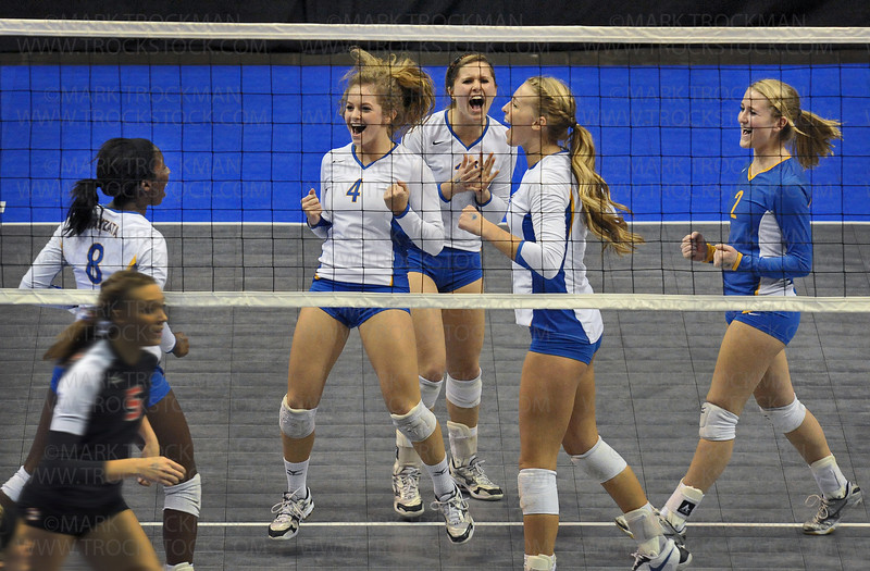 The Wayzata volleyball squad, left to right, Toni Okuyemi, Mikayla Greely, Bri Adams, Julia Doyle, and Lauren Hoag celebrate a hard-fought point against Lakeville North in early action during the class 3A state championship match held at the Xcel Energy Center in St. Paul Saturday, Nov. 13.  In the end the Trojans lost to the Panthers 25-13, 25-18, 25-13.