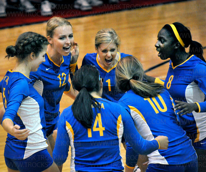 The Wayzata squad celebrates a point against Shakopee Tuesday, Sept. 14, 2010.  The Trojans beat the Sabers 25-23, 25-20, 25-18, in Shakopee.