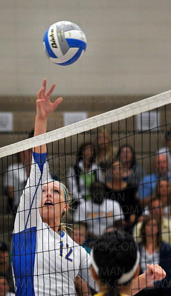 Wayzata's senior setter and team captain Julia Doyle moves the ball into position against Apple Valley Tuesday, Aug. 30, at Wayzata High School in Plymouth.  The Trojans defeated the Eagles 25-20, 25-13, 24-26, 25-20.