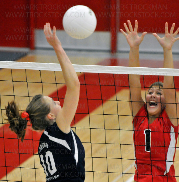Orono outside hitter Lexi Rinde, left, surprises Mound setter Callie Mack in first-game action Sept. 15 in Orono.