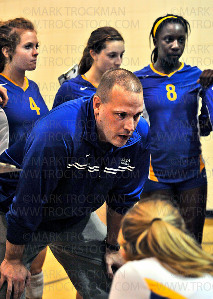 Trojans head coach Scott Jackson strategizes with his varsity squad during a timeout in the Trojans match against Shakopee Tuesday, Sept. 14, 2010.  Wayzata beat the Sabers in Shakopee 25-23, 25-20, 25-18.