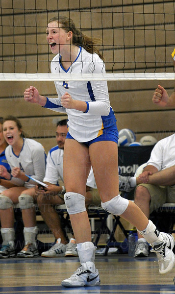 Trojans junior outside hitter Natalie Wilson celebrates an early point against Apple Valley Tuesday, Aug. 30, at Wayzata High School in Plymouth.  The Trojans defeated the Eagles 25-20, 25-13, 24-26, 25-20.
