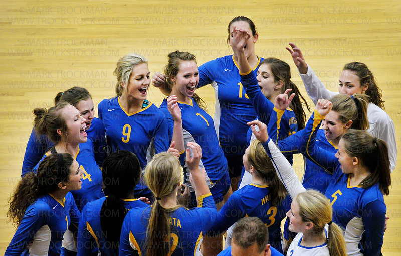 The Wayzata varsity volleyball squad is psyched up after an early win  against the formidable Eden Prairie defense Thursday, Oct. 13, at Eden Prairie High School.  Wayzata ultimately lost the match 3-2 with game scores, 25-17, 17-25, 25-20, 17-25, 15-10.