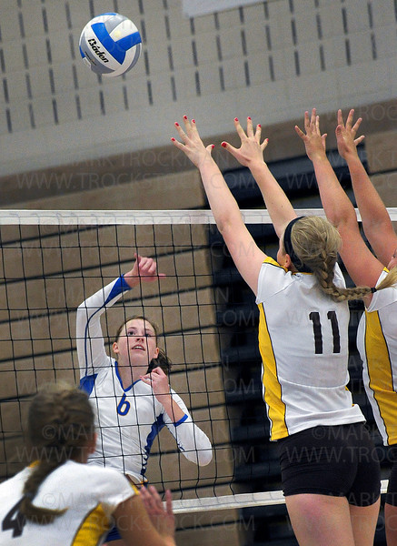 Trojans junior outside hitter Natalie Wilson puts one past the Apple Valley stoppers Tuesday, Aug. 30, at Wayzata High School in Plymouth.  The Trojans defeated the Eagles 25-20, 25-13, 24-26, 25-20.