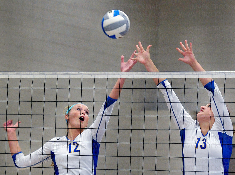 Wayzata's senior setter Julia Doyle and senior middle hitter Jesse Miller block a shot from Apple Valley Tuesday, Aug. 30, at Wayzata High School in Plymouth.  The Trojans defeated the Eagles 25-20, 25-13, 24-26, 25-20.