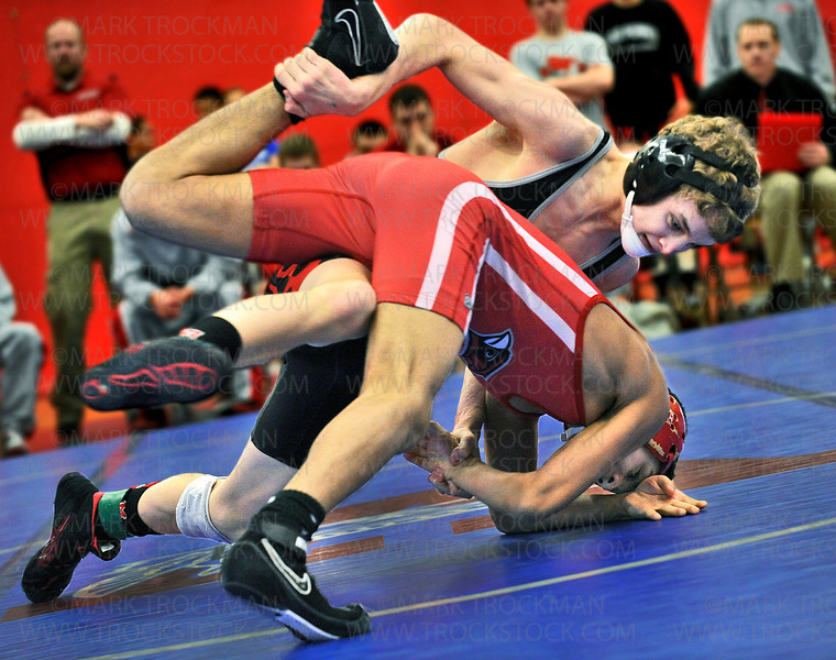 113-pound Mound-Westonka grappler Sam Bennyhoff, top, beat Wilmer's  Juan Resendez 13-5 in their Section 6, semifinal match at Robbinsdale Armstrong High School Saturday, Feb. 16, in Plymouth.