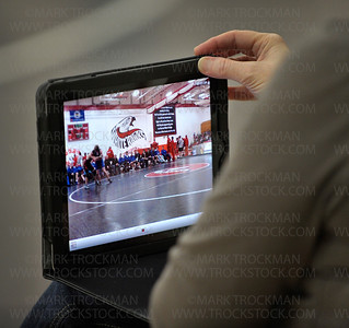 Deb Bennyhoff records Mound-Westonka wrestling matches on her iPad Saturday, Feb. 18, during the Section 6-3A Team Wrestling Tournament in Mound.
