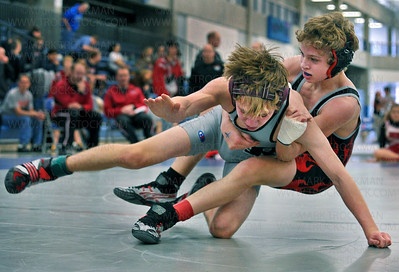 106-pound Mound-Westonka wrestling sensation Sam Bennyhoff, right, takes his Richfield-Edina opponent, Justin Swetala, for a Leg Ride, scoring points on his way to another defeat and a first place finish Saturday, Jan. 7, at the Hopkins Paul Bengston Invitational Tournament.